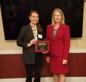 Lindsay Jewell of Perkins Coie LLP accepts the recognition for Furthering the Mission of AWLS from Justice Ann Scott Timmer