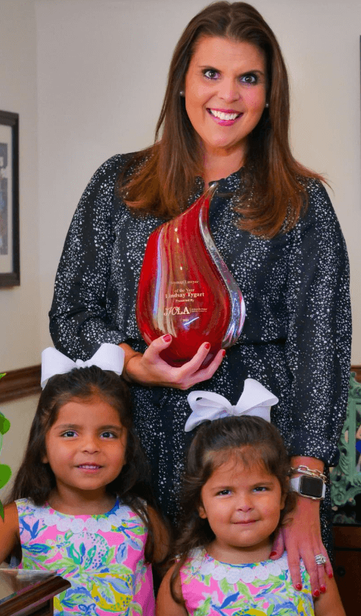 2020 Woman of the Year Lindsay Tygart with her daughters.