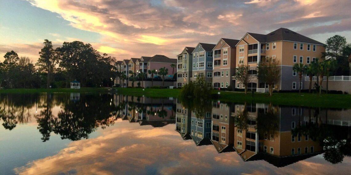 Florida condo unit during sunset reflecting off lake