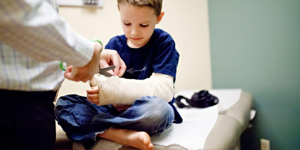 boy getting cast removed after personal injury case in Mobile, Alabama