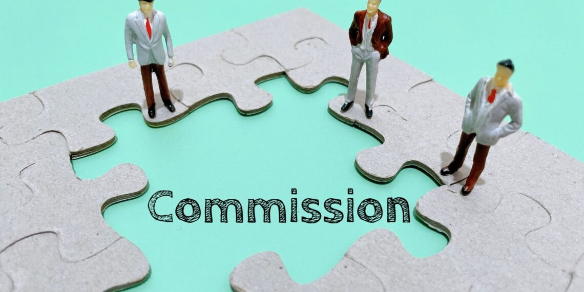 Picture of three business man standing around the word commission as they are discussing methods some Tampa employers use to short workers commissions