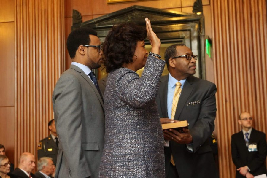Beasley takes the oath of office.