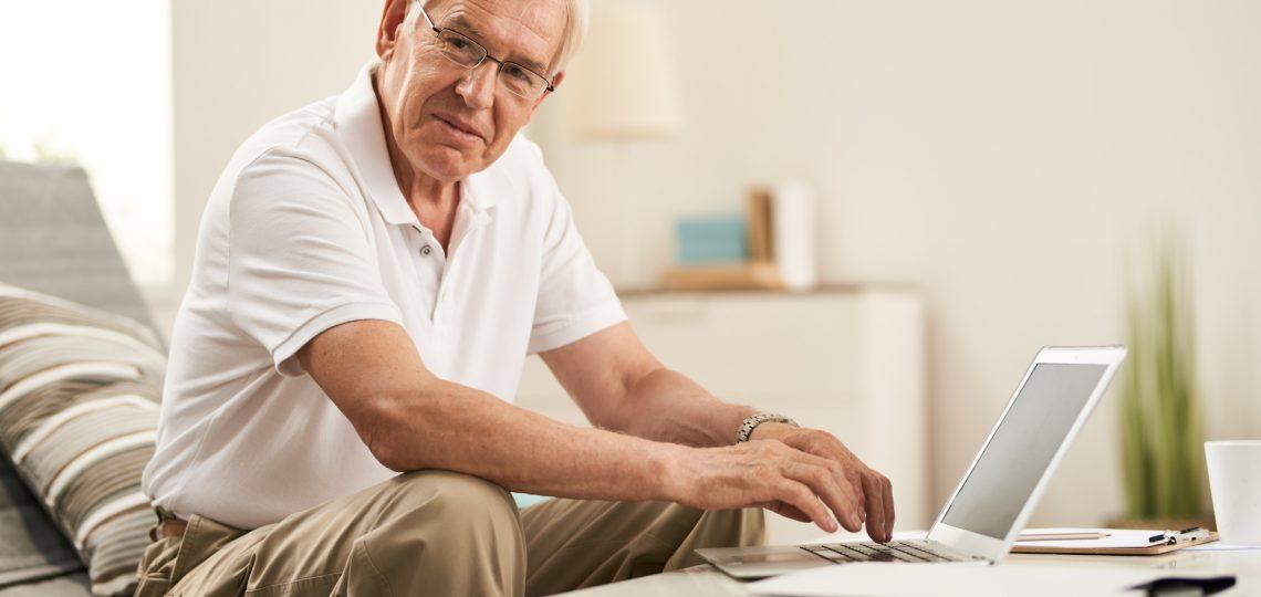 Senior Man Working at Home