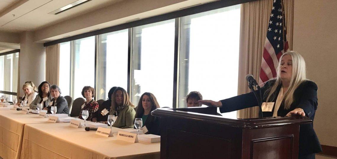"Elizabeth ""Betsy"" White addresses the panel."