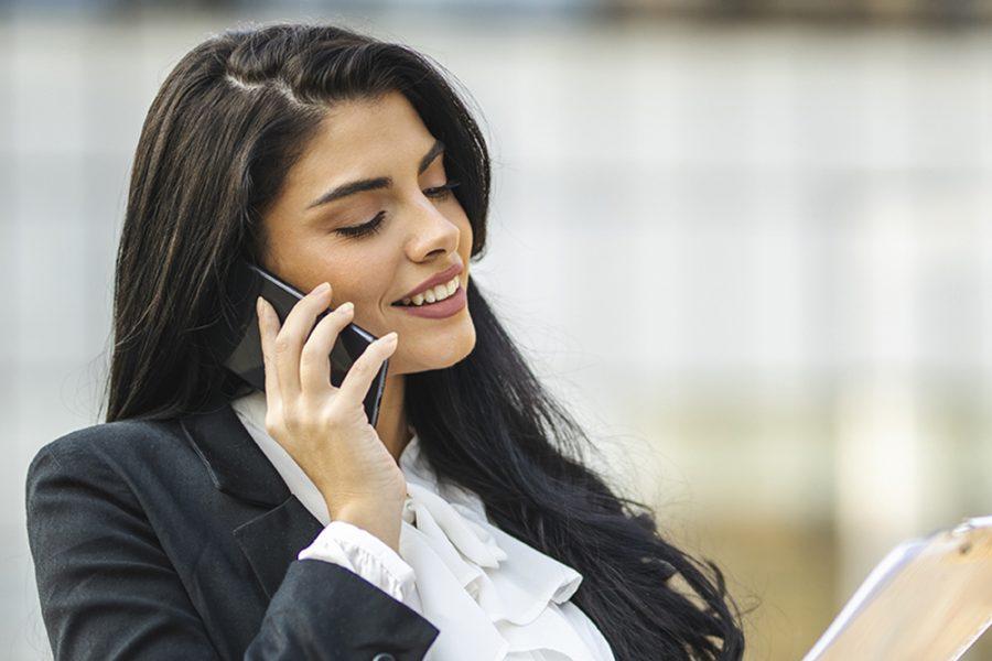 Portrait of businesswoman using mobile phone