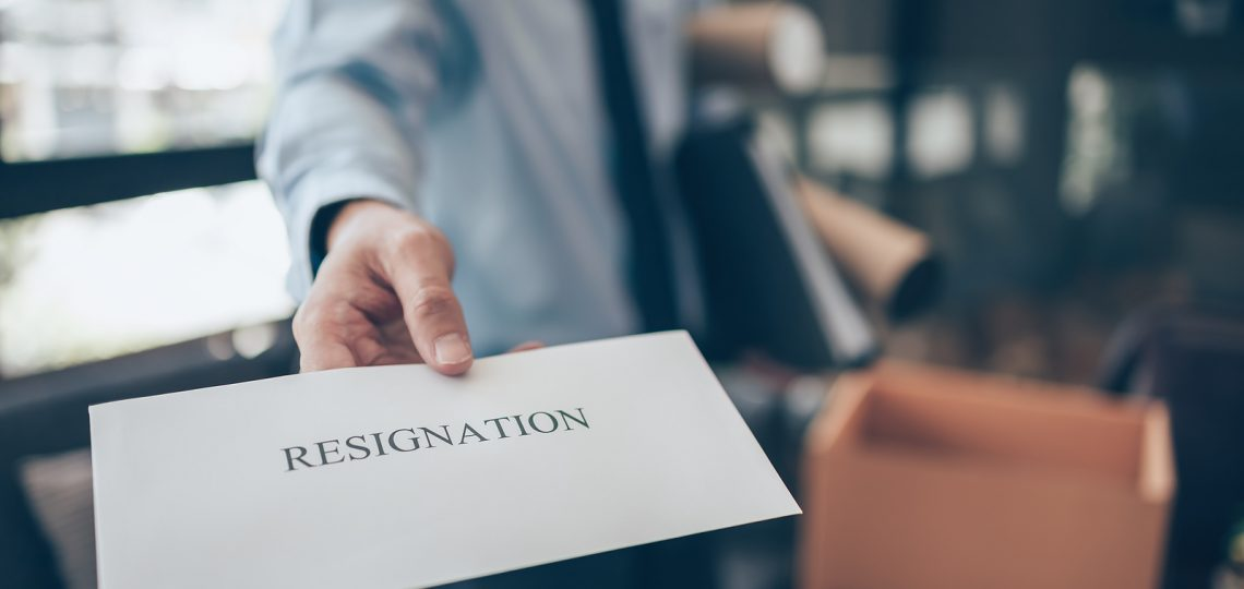 Businessman sending and showing resignation letter to employer boss. Quitting a job, businessman fired or leave a job concept.